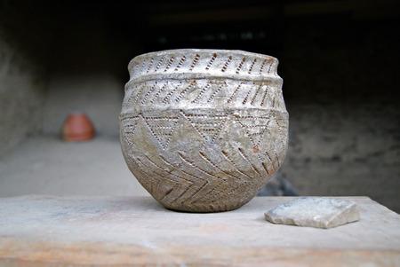 A replica of the Bronze Age ceramics - a handmade pot of gray baked clay close-up