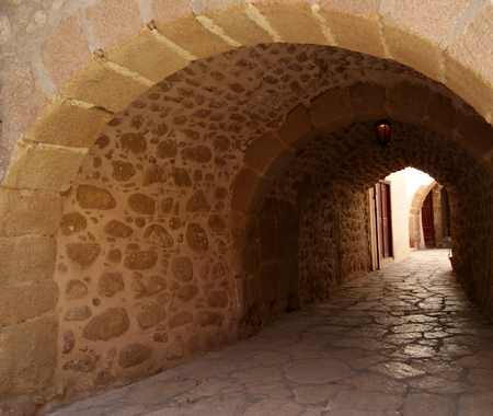 Semi-dark passage with a stone arched vault in the monastery of St. Catherine, Sinai (one of the oldest working Christian monasteries in the world) without people.