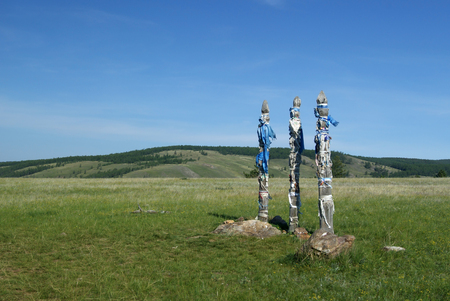 Three banded totem poles (