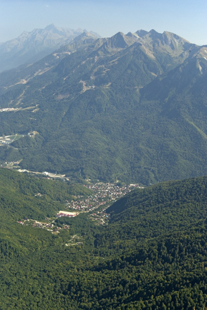 View of the village of Krasnaya Polyana from the top of the Achishkho mountain Stock Photo
