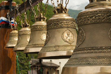 RUSSIA, SOCHY - september 27, 2017: row of traditional Orthodox bells of different sizes in the bell gable