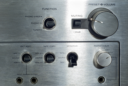 Front panel section of audio power amplifier with switches and knobs