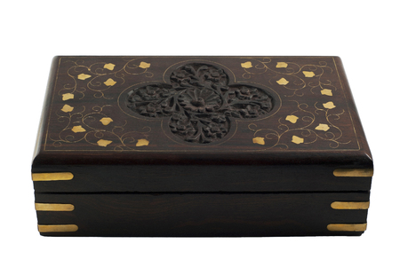 Isolated dark-brown wooden casket with inlay and carved pattern in Indian style