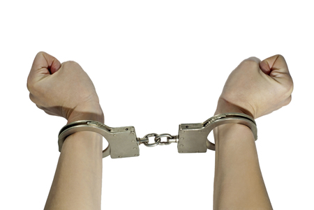 female hands trying to tear handcuffs, isolated
