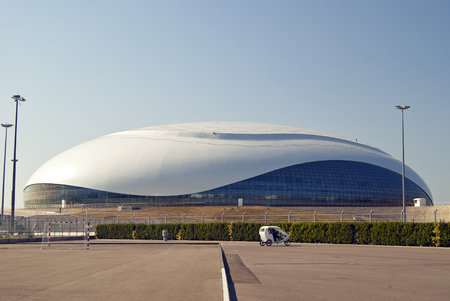 SOCHY, RUSSIA - SEPTEMBER 20, 2017: general view of the Bolshoy Ice Dome with a bicycle in the foreground