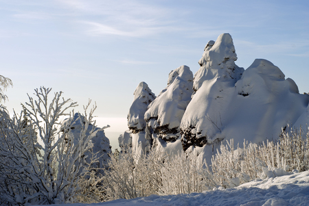 winter landscape with snow-covered rocks on the top of the Ural ridge is the border between Europe and Asia in the Middle Urals