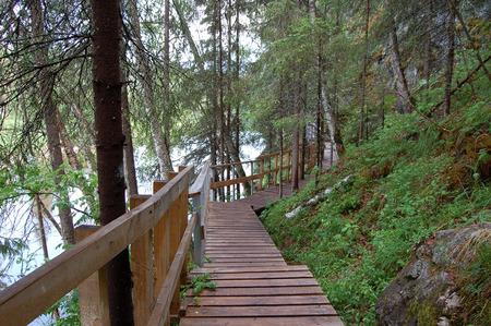 Wooden gangway along a steep mountain slope on a tourist route in a natural park Stock Photo