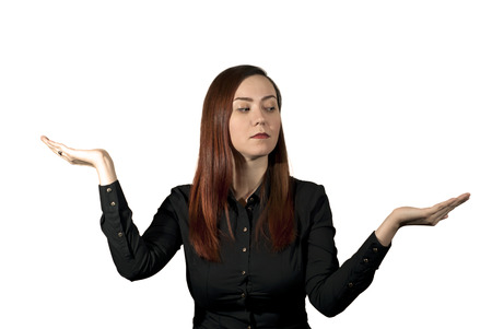 woman on a white background holds her palms like a bowls of scales and looks thoughtfully at one hand, as if weighing the pros and cons