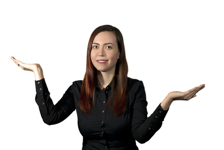 smiling woman on a white background holds her palms like a bowls of scales, as if weighing the pros and cons