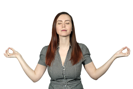 woman on a white background with closed eyes and a calm expression of her face meditates with arms outstretched Stock Photo