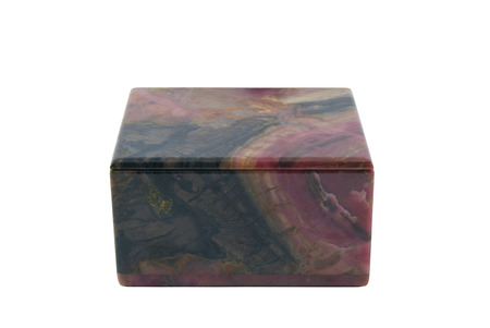 small simple box of polished rhodonite isolated