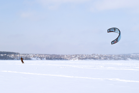 PERM, RUSSIA - FEBRUARY 23, 2018: snowkiter glides on the ice of the Kama Reservoir