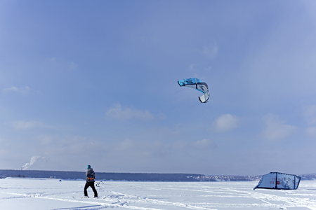 PERM, RUSSIA - FEBRUARY 23, 2018: snow kiter glides on the ice of the Kama Reservoir
