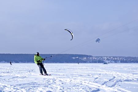 PERM, RUSSIA - FEBRUARY 23, 2018: snow kiters glides on the ice of the Kama Reservoir Editorial