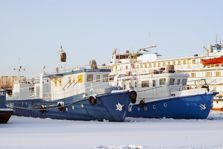 ruver tugboats and passenger vessel during wintering in the backwaters Stock Photo