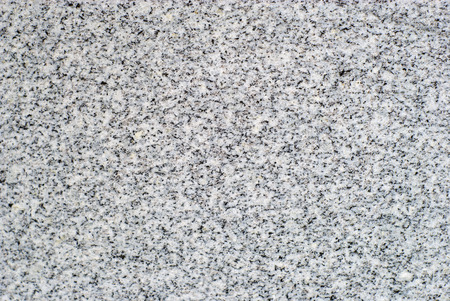 background, texture - surface of a polished slab of gray variegated granite