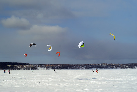 PERM, RUSSIA - MARCH 09, 2018: snow kiters glides on the ice of the Kama Reservoir