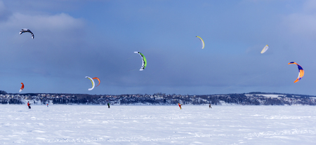 PERM, RUSSIA - MARCH 09, 2018: snowkiters rides on the ice of the Kama Reservoir