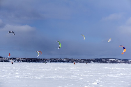 PERM, RUSSIA - MARCH 09, 2018: snow kiters rides on the ice of a frozen river Editorial