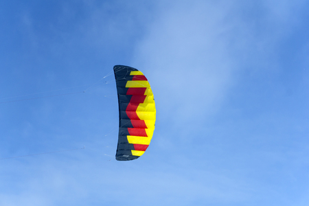 bright multicolored sports kite for kiting or snowkiting against the blue sky Stock Photo