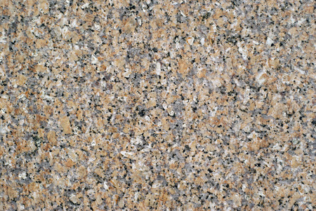 background, texture - surface of slab of gray granite with orange splashes