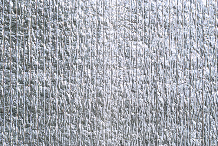 background, texture - silvery wrinkled surface of thermal insulating foil
