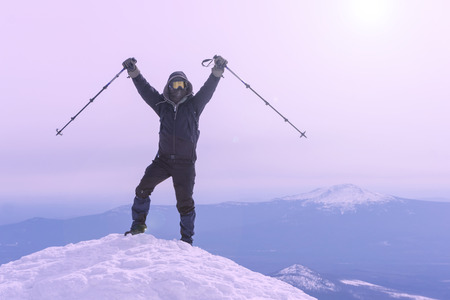 mountaineer exults reaching the top of the mountain peak