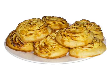 Shangy (plural form of shanga) - traditional Ural open baked pies with mashed potatoes - on a plate, isolated on white background