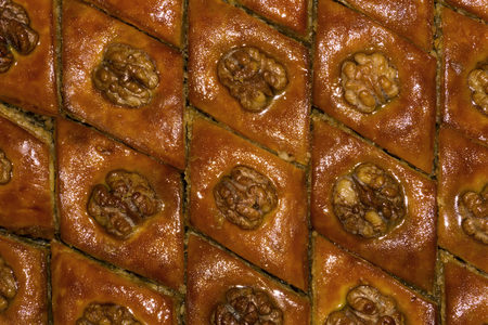 background - oriental sweets, baklava baklava with walnut, lying in a continuous layer on a sheet