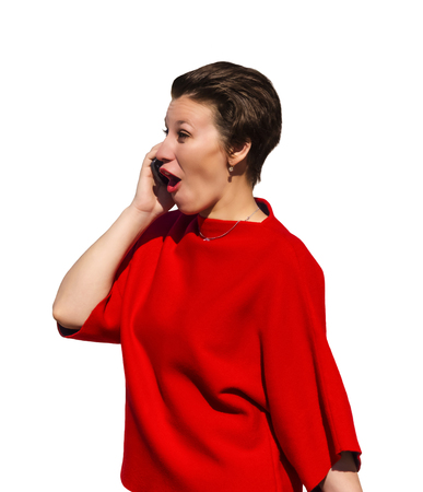 woman in a red suit talking on the phone with a comical rapturous expression, isolated on white background