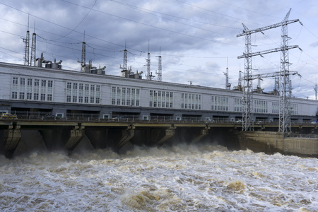 dam hydroelectric power station on the river during the discharge of flood waters 스톡 콘텐츠