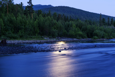 Night landscape - a reflection of the moon in the river among the forest in the Ural mountains Stock Photo