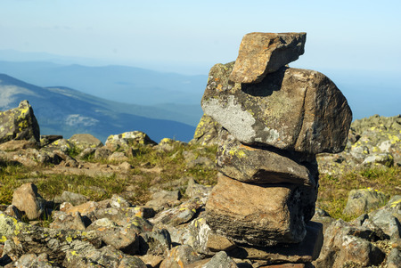stone pyramid - a road sign on the mountain pass, reminiscent of a primitive sculpture Stock Photo