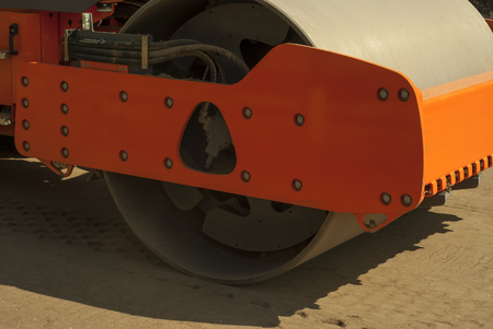 sealing drum of roller-compactor that compacts the sandy base of the road