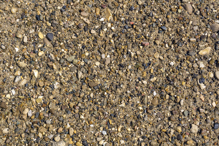 background, texture - small pebbles and sand on the river bank