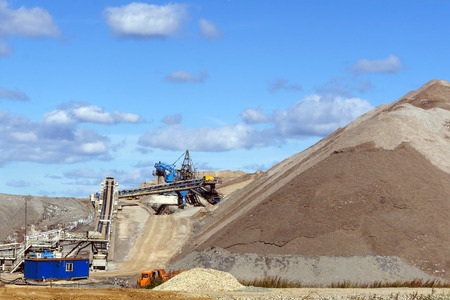 dumps of mined rock with a system of belt conveyors and spreaders, general view 写真素材