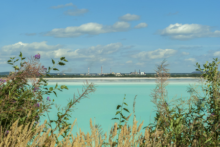 industrial tailing pond with beautiful blue water on the background of the factory landscape Reklamní fotografie