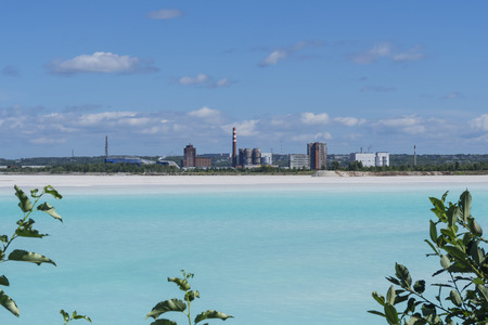 industrial tailing pond with beautiful blue water on the background of the factory landscape 写真素材