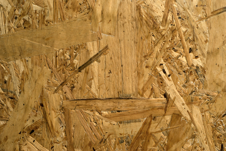 background, texture - surface of rough chipboard close-up Banco de Imagens