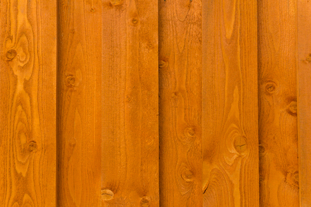 background - wall of vertical painted orange boards