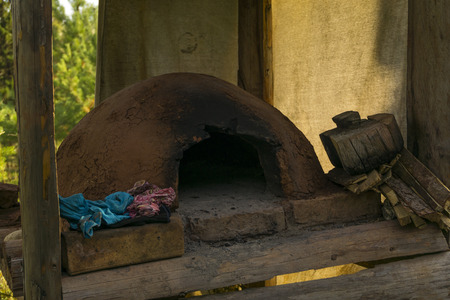 primitive dome-shaped clay oven in the aboriginal settlement