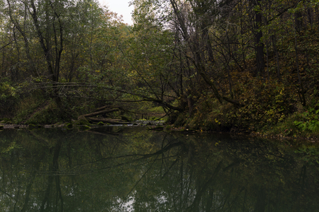 deep lost forest karst lake in the autumn dusk Stock Photo