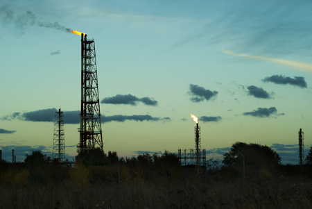 night silhouette industrial landscape - flares for flaring associated gas in an oil field Stok Fotoğraf