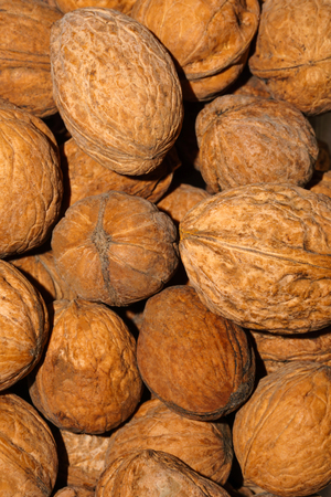 background - natural inshell walnuts