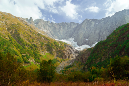 mountain landscape with a melting glacier in a valley in the North Caucasus