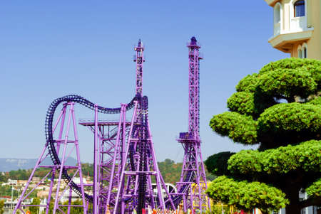 purple roller coaster structures in the city's amusement park