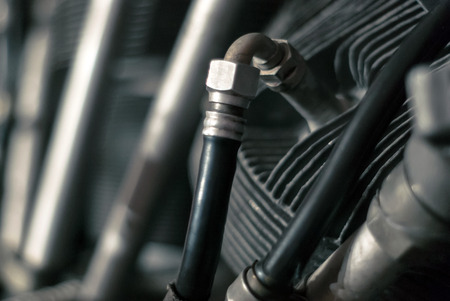 fragment of the cylinder of an aircraft piston engine with a fuel supply system, partially blurred background Stock Photo