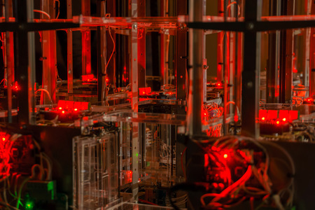 Abstract technological background with metal and plastic structures, electronics and LEDs