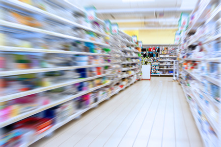 interior with shelves of household goods store in radial blur Stock Photo
