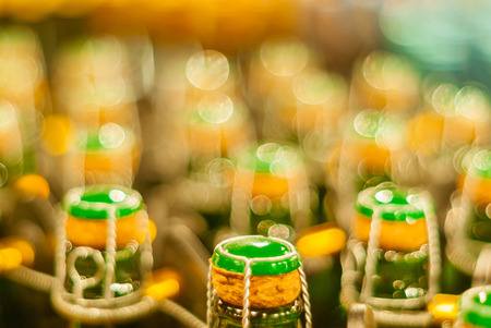 blurred background - corks on bottles of sparkling wine Stok Fotoğraf - 114027482